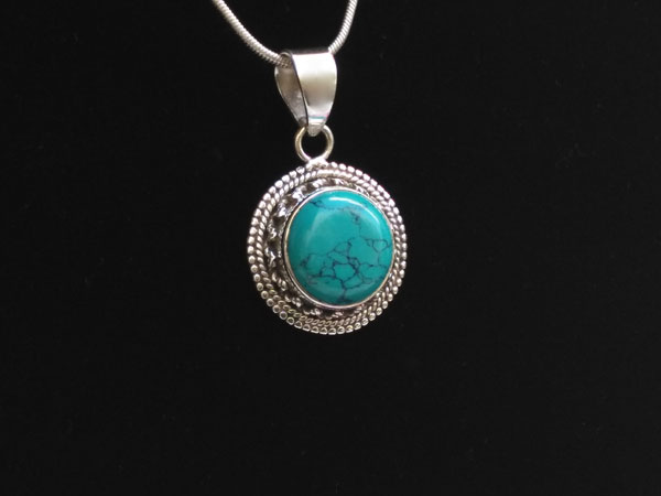 Silver and Turquoise ethnic pendant.. Foto 1