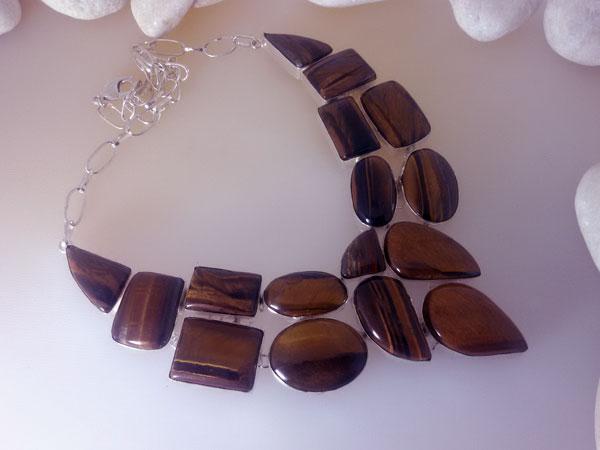 Conjunto de collar y pulsera de plata y gemas de ojo de tigre.. Ref. JMR