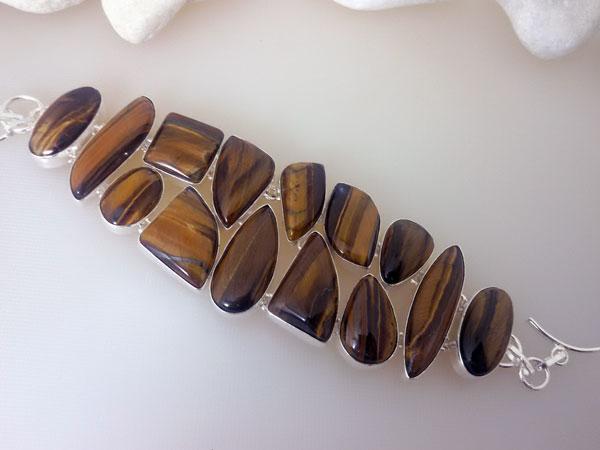 Conjunto de collar y pulsera de plata y gemas de ojo de tigre.. Foto 2