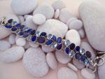 Sterling silver bracelet with aquamarine, tanzanite and labradorite gems.. Ref. TXV
