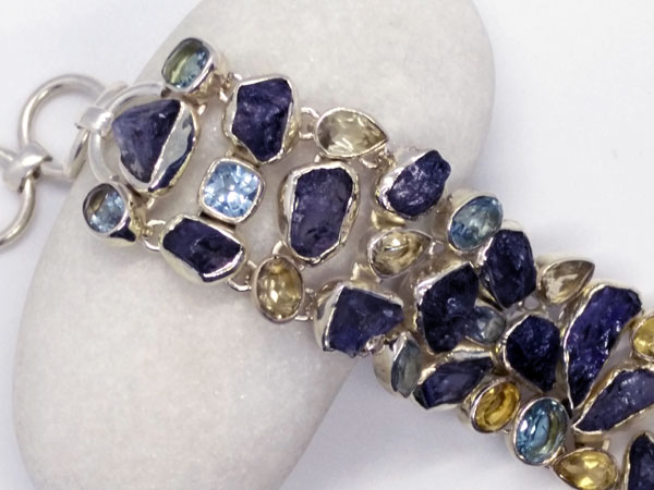 Silver bracelet with Tanzanite and Topaz gems.. Foto 2