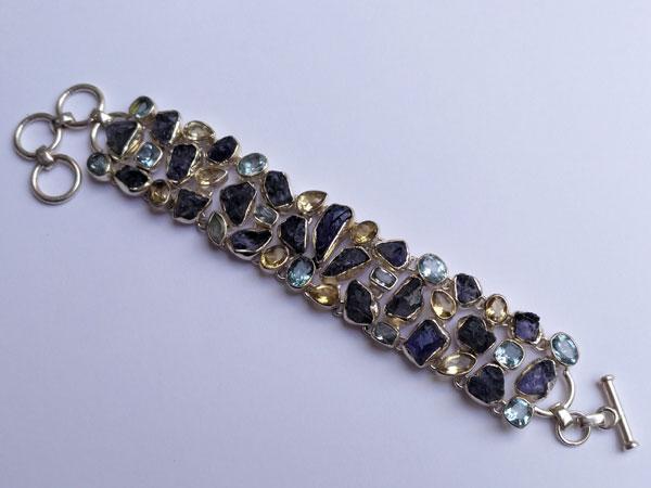 Silver bracelet with Tanzanite and Topaz gems.. Foto 4