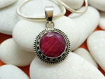 Sterling silver pendant with a ruby gem.. Ref. XAU